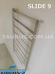 Очень узкий полотенцесушитель Slide 9 размером 950х400 мм. Перекладины под углом до 30 градусов. Н/ж сталь