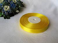 Лента 1,2 атлас однотонная.  Цвет желтый. Бобина 18 грн - 33 метра, на метраж 1 грн - метр.