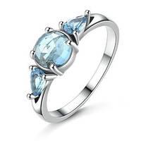Кольцо из серебра с голубыми камнями