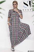Стильное красивое платье в абстрактный принт, украшено пуговицами.