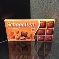 Молочный шоколад с миндальным кремом и кусочками миндаля Schogetten Almond Brittle