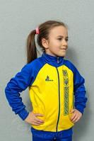Особенности выбора детского костюма для занятия спортом