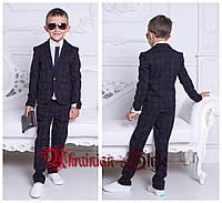 Трикотажный клетчатый костюм для мальчика: брюки и пиджак