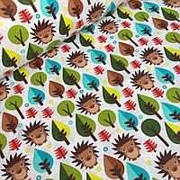 Ткань ,коричневые ёжики и деревья разных цветов на белом фоне
