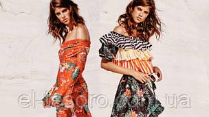 Тренд: блузы с открытыми плечами и оборками