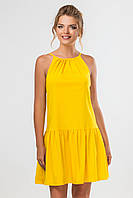 Желтое платье-сарафан выше колена с завязками на спинке