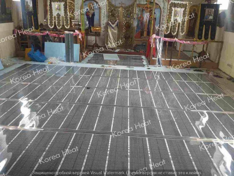 Монтаж инфракрасного пленочного пола в храме
