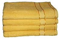 Однотонное желтое полотенце махровое с бордюром 100% хлопок эконом