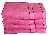 Однотонное розовоеполотенце махровое с бордюром 100% хлопок эконом