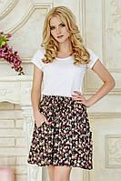 Летняя женская юбка в цветочек до колен с карманами
