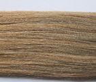 Натуральные пряди волос на заколках.