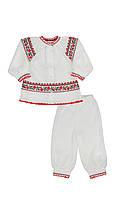 Комплект для новорожденной: вязаная вышиванка и штанишки