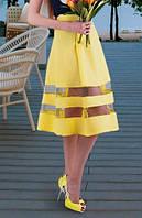 Желтая юбка с полосками из сетки