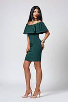 Женское платье изумрудного цвета