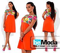 Привлекательное женское платье с цветочной вышивкой на груди оранжевое