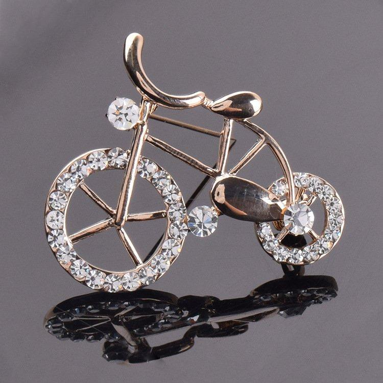 Жіноча брошка Bicycle