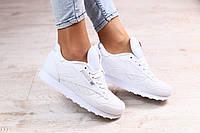 Женские белые кроссовки кожа