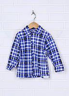 Рубашка на пуговицах с длинным рукавом. Манжеты на рукавах застегиваются на пуговицы.