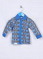 Рубашка на пуговицах с длинным рукавом комбинированная. Манжеты на рукавах застегиваются на пуговицы.