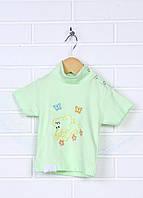Футболка из интерлока для детей. Плече застегивается на кнопки.  Декорирована вышивкой.