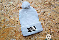 Стильная белая шапка с бубоном The North Face Beanie