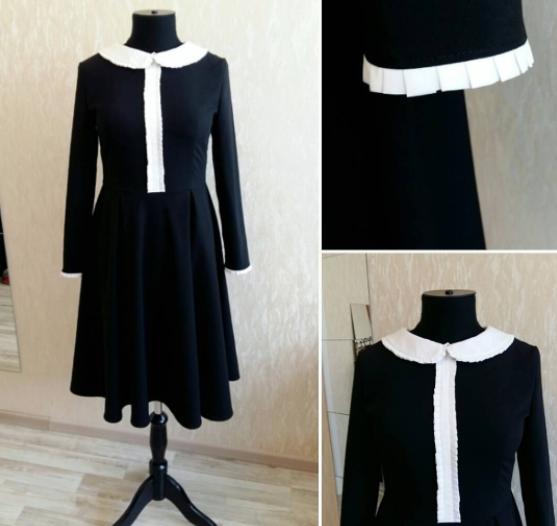 Черное платье с летящей юбкой-полусолнце и контрастной отделкой.