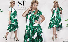 Эффектное платье, свободный фасон, асимметричный низ с воланами.