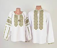 Пара вишиванок білого кольору з зеленим орнаментом ручної роботи