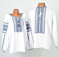 Пара вишиванок білого кольору з блакитним орнаментом ручної роботи