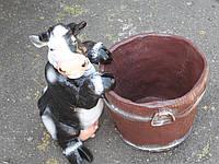 Корова с кадкой