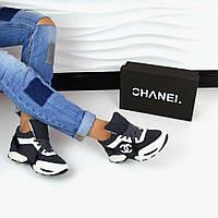 Актуальные кроссовки темно-серого цвета в стиле современного бренда