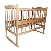Кроватка детская КФ ольха  светлая  с фигурной спинкой,откидным боком,колесиками и качалкой 20018