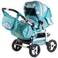 Детская коляска-трансформер Adamex Galaxy белая кожа-бирюзовый (цветики) 620316