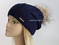 Вязаная шапка Рузанна с помпоном из меха енота
