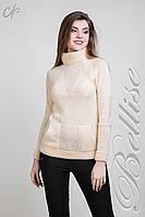 Модный женский вязаный свитер крупной вязкой и высоким воротником