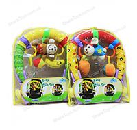 Развивающая дуга с игрушками на коляску