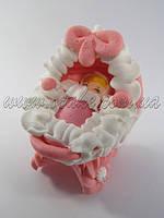 Ребеночек в розовой колясочке