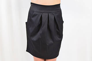 Красивая интересная детская школьная юбка с эффектными складами.
