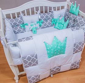 Незвичайний Комплект в дитяче ліжечко з 11 позицій.