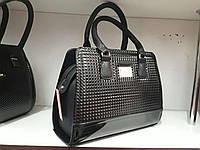 Женская лаковая сумочка черного цвета