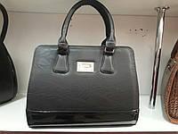 Стильная женская сумка с лаковой вставкой