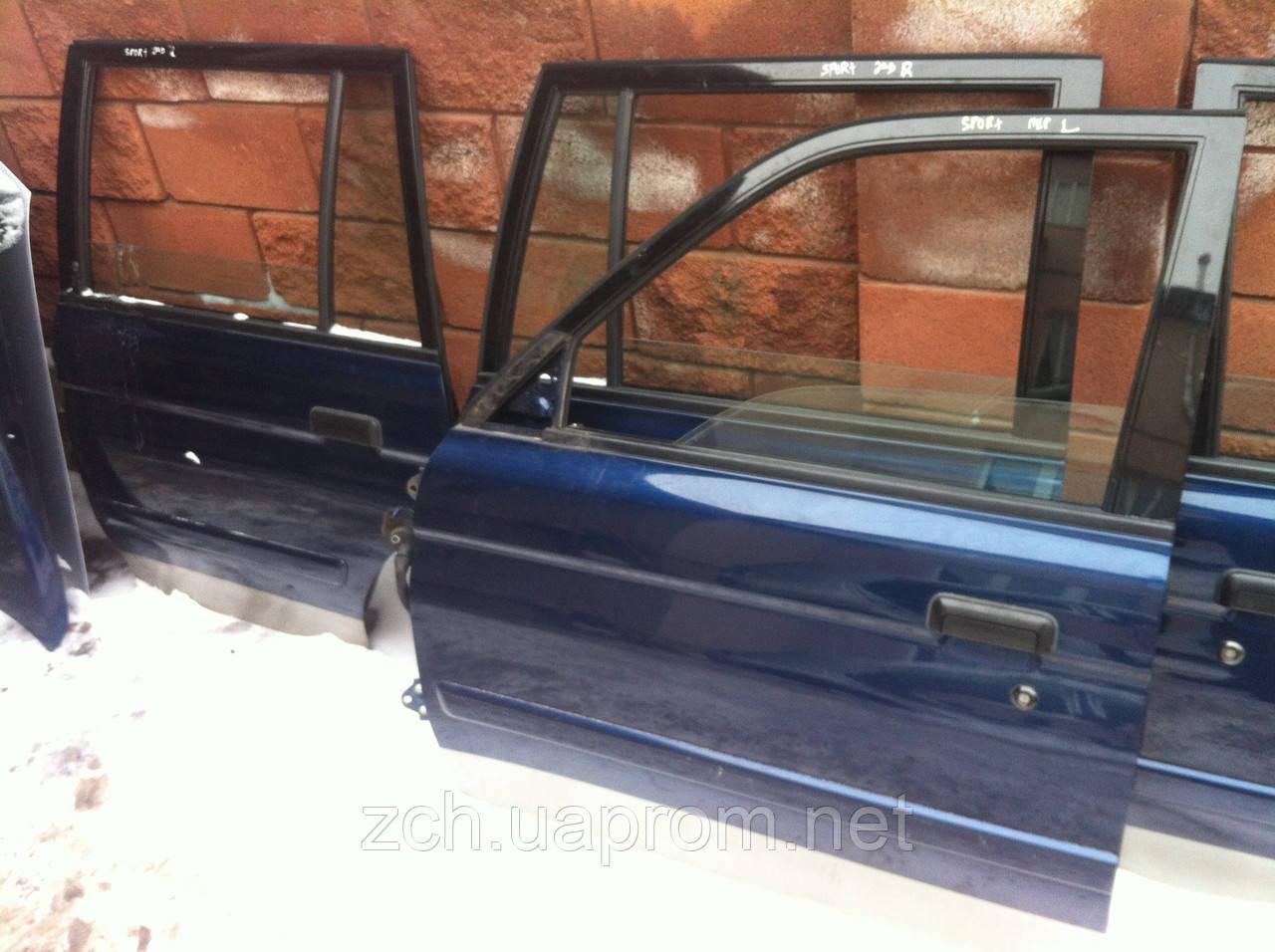 Скло двері Mitsubishi Pajero Sport