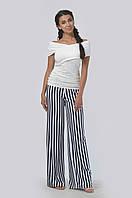 Комфортные и стильные брюки свободного покроя, выполненные из мягкой и приятной ткани
