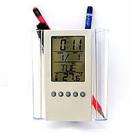Подставка для канцтоваров с электронными часами и термометром.