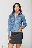 Джинсовая куртка с оригинальной вышивкой на спине