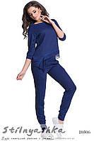 Модный трикотажный костюм с кружевом синий