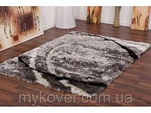 Сучасний килим сірого кольору зі смугами чорного і білого кольору