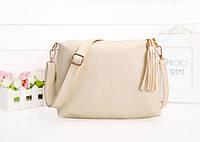 Удобная сумка с кисточкой и длинным поясом