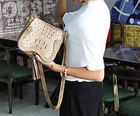 Оригинальная сумочка под кожу питона с кисточкой