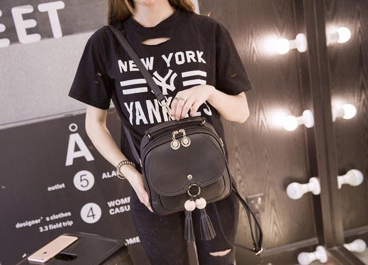 Модный городской рюкзак с кисточками